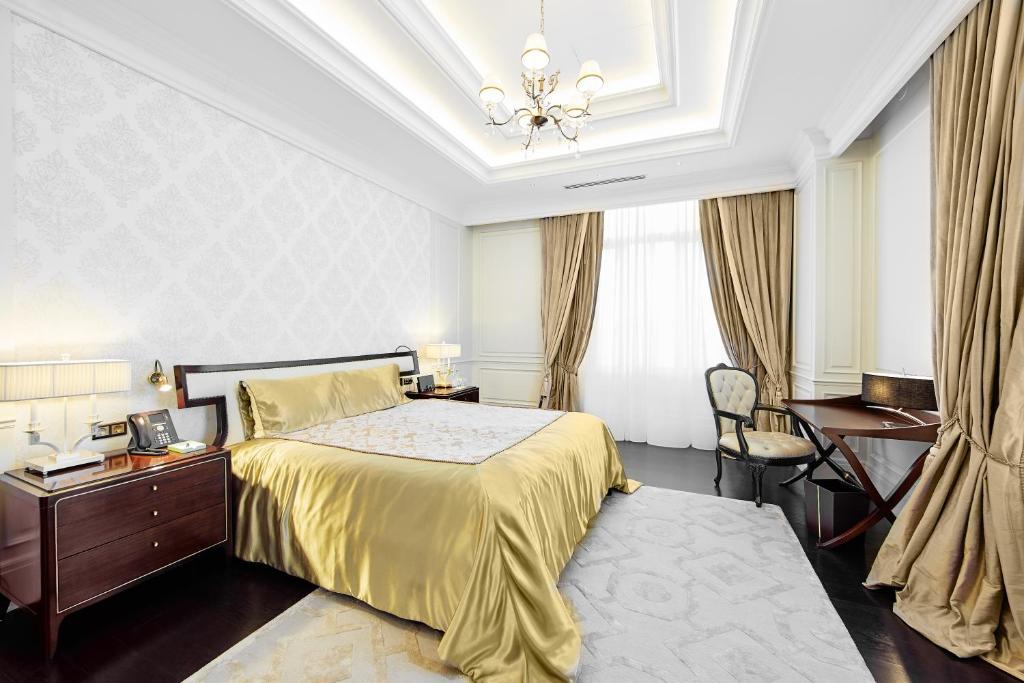 Кровать или кровати в номере Отель Корпоративный Центр Сбербанка