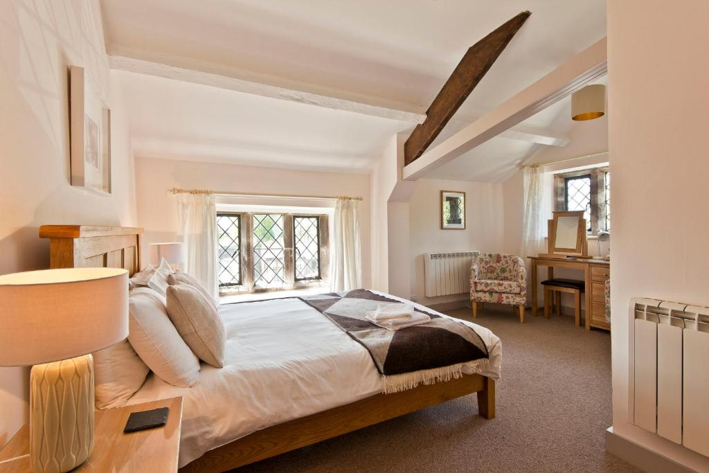 A bed or beds in a room at Swarthmoor Hall