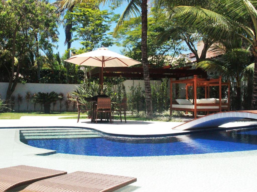 The swimming pool at or close to Hotel Boutique Recanto da Passagem