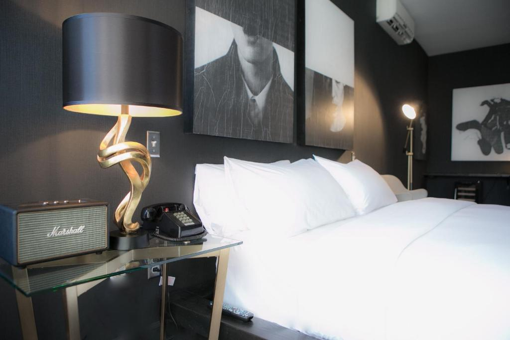 Krevet ili kreveti u jedinici u objektu Tuck Hotel