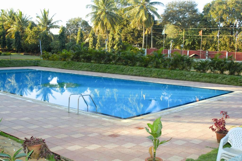 The swimming pool at or close to Royal Orchid Resort & Convention Centre