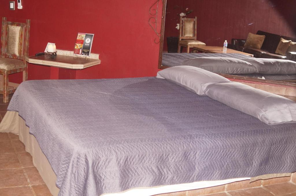 A bed or beds in a room at Palapa 206