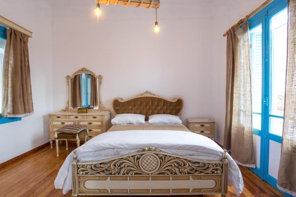 Ein Bett oder Betten in einem Zimmer der Unterkunft The House