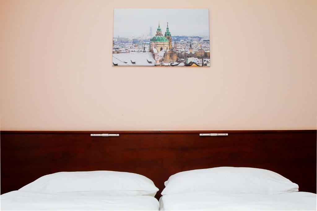Ein Bett oder Betten in einem Zimmer der Unterkunft Hotel Inturprag