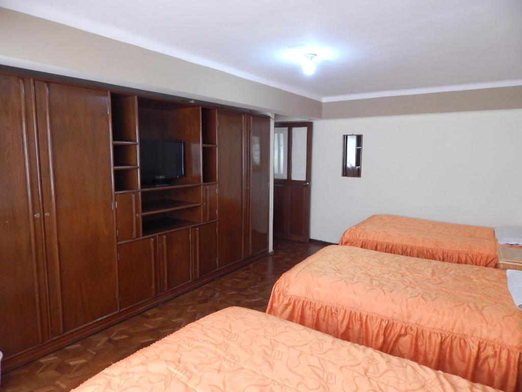 A bed or beds in a room at Casa de Huespedes Isabella