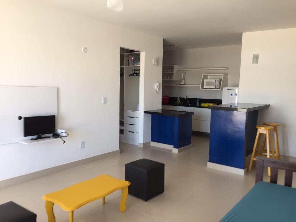 A kitchen or kitchenette at Varandas da Praia Apartamentos