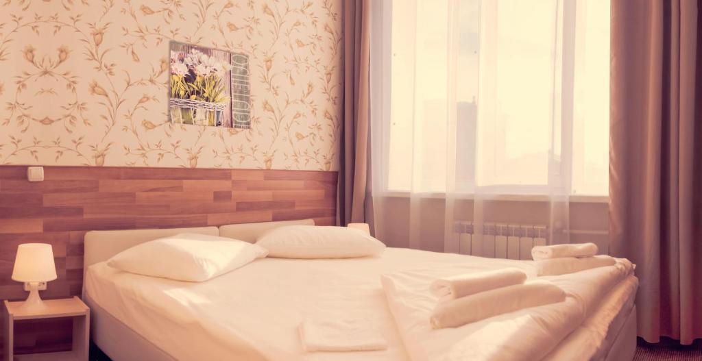 A bed or beds in a room at Ahouse Hotel on Nakhimovsky Prospekt