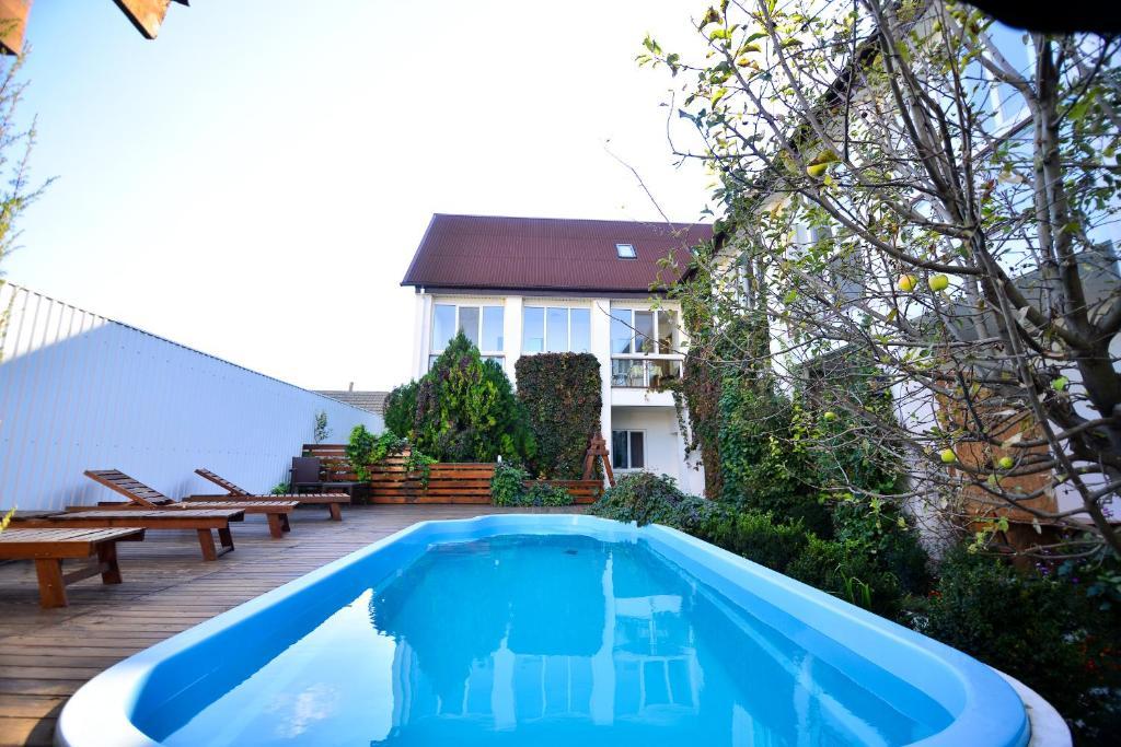 The swimming pool at or near Dynastya Inn