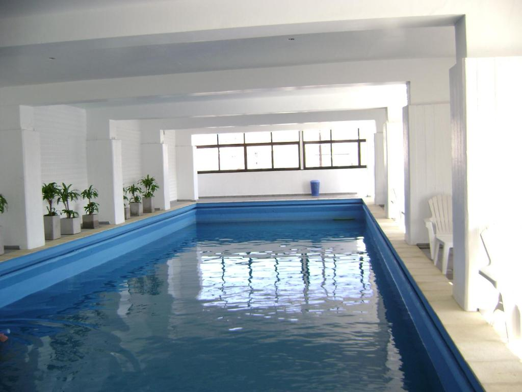The swimming pool at or near Grand Hotel