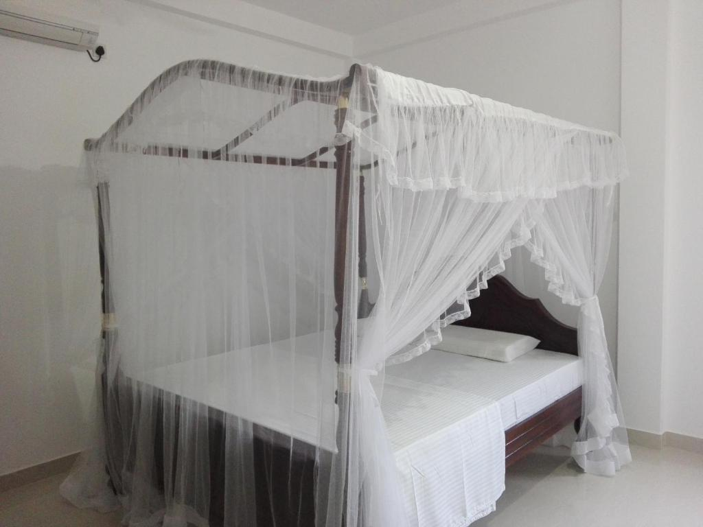 A bed or beds in a room at Mirissa Cocoon