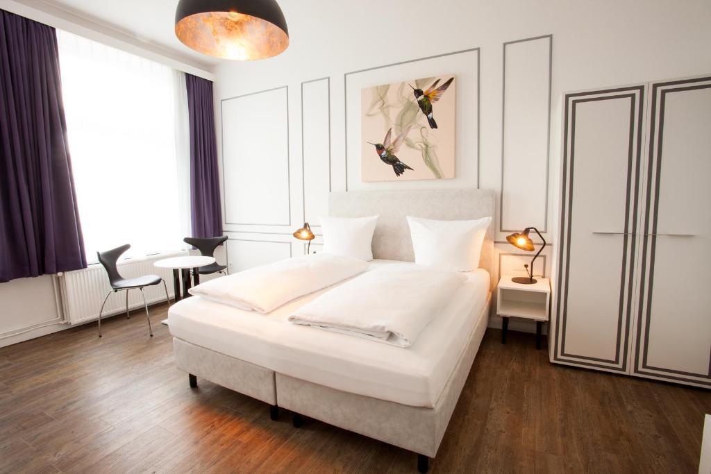 Ein Bett oder Betten in einem Zimmer der Unterkunft Boutique 056 Hamburg Central