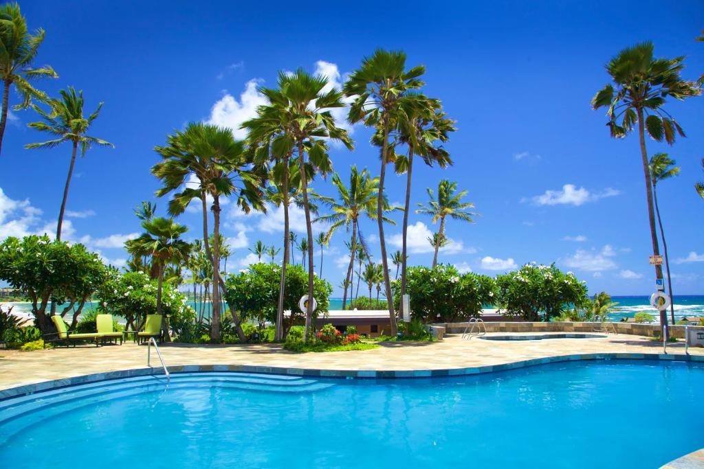 The swimming pool at or near Hilton Garden Inn Kauai Wailua Bay, HI