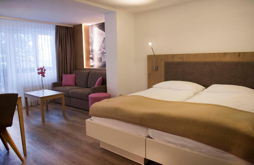 A bed or beds in a room at Residence Patricia
