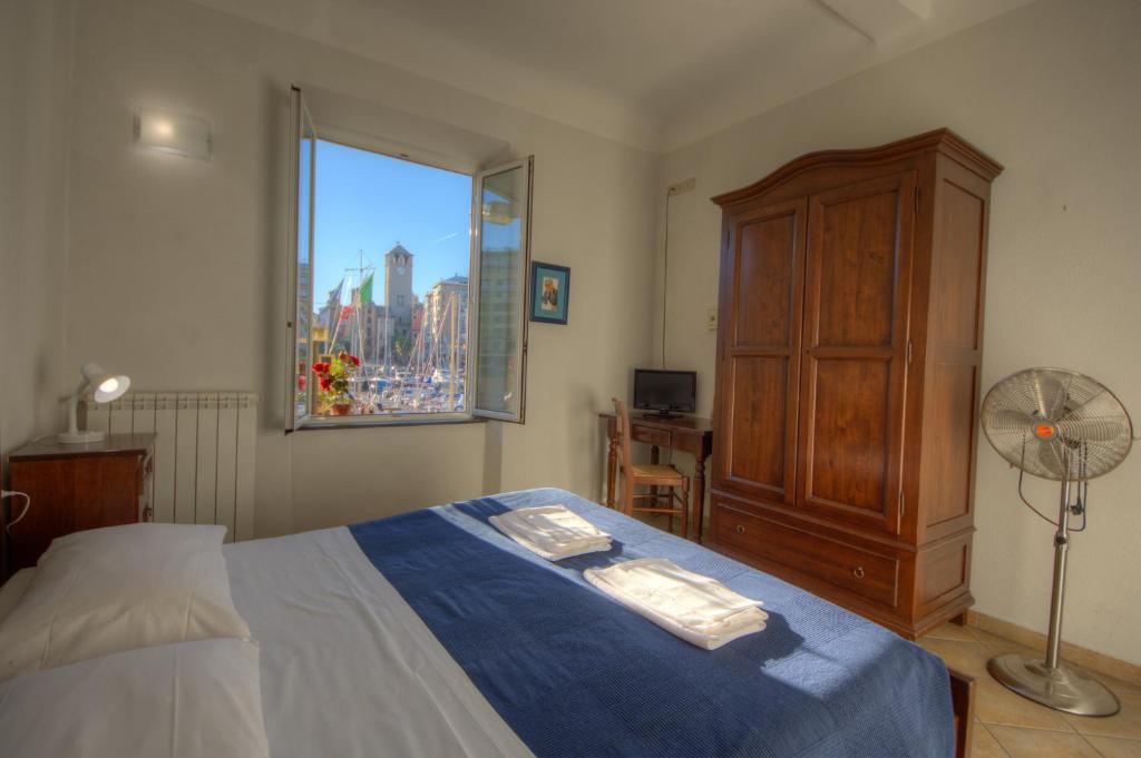 A bed or beds in a room at Club Nautico Savona