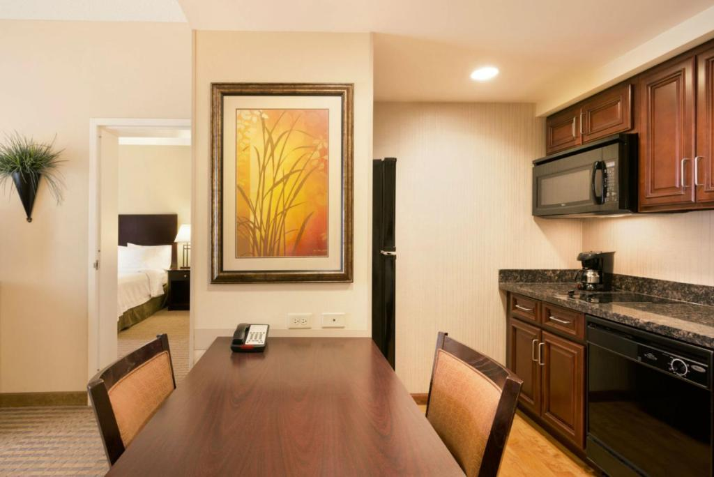 A kitchen or kitchenette at Homewood Suites New Brighton