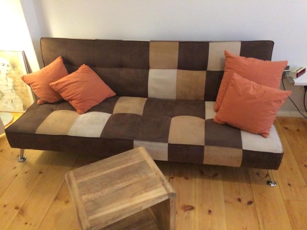 A seating area at Lodge Berlin - Apartments