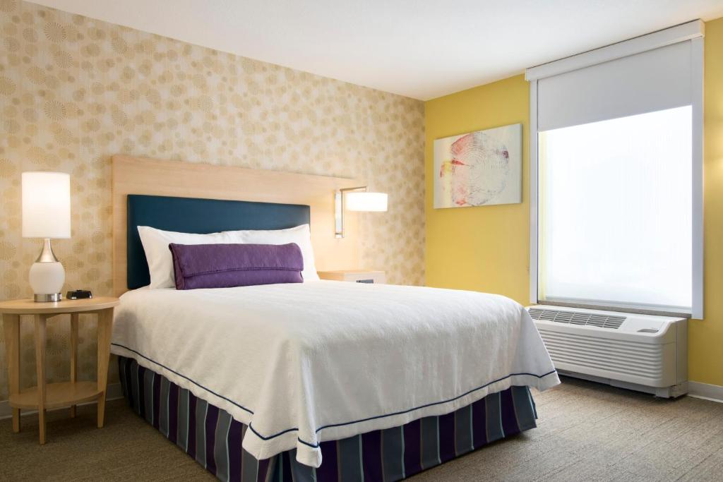 A bed or beds in a room at Home2 Suites by Hilton Fort St. John