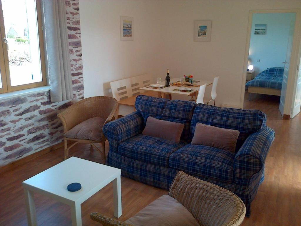 A seating area at Clubhouse Gites