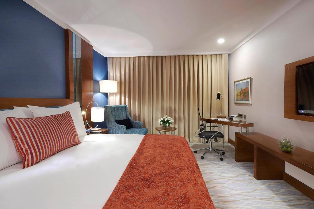 سرير أو أسرّة في غرفة في ديفان مرسين
