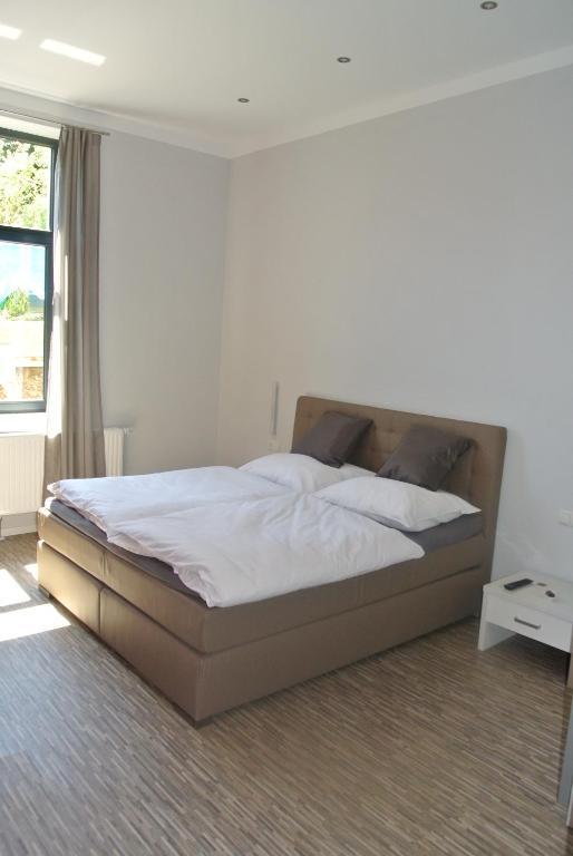 Postel nebo postele na pokoji v ubytování Gästehaus Tappes Hofgarten