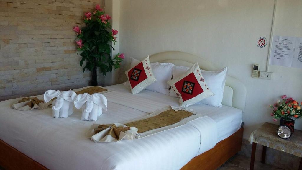A bed or beds in a room at Houayxai Riverside Hotel (Phonevichit Guesthouse)