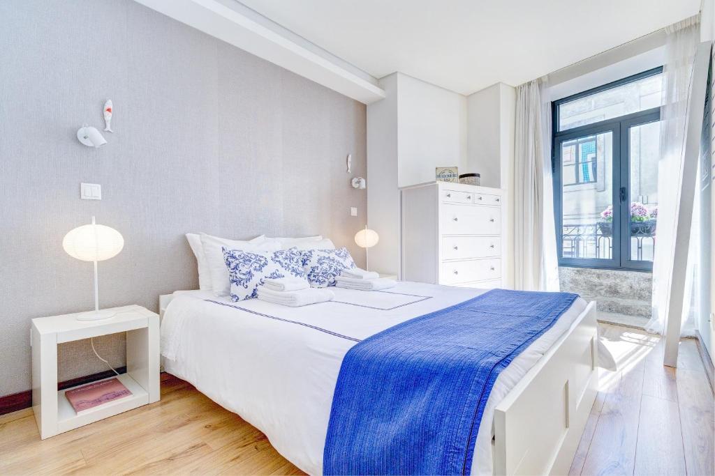 Ein Bett oder Betten in einem Zimmer der Unterkunft Casa Portuguesa