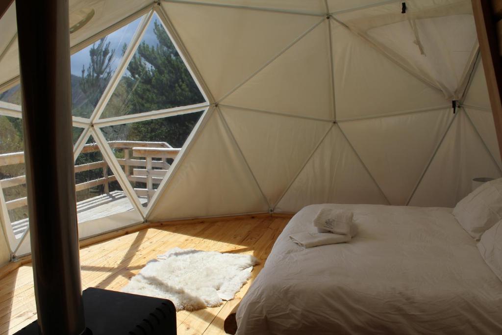 Cama o camas de una habitación en Baker Domo Lodge