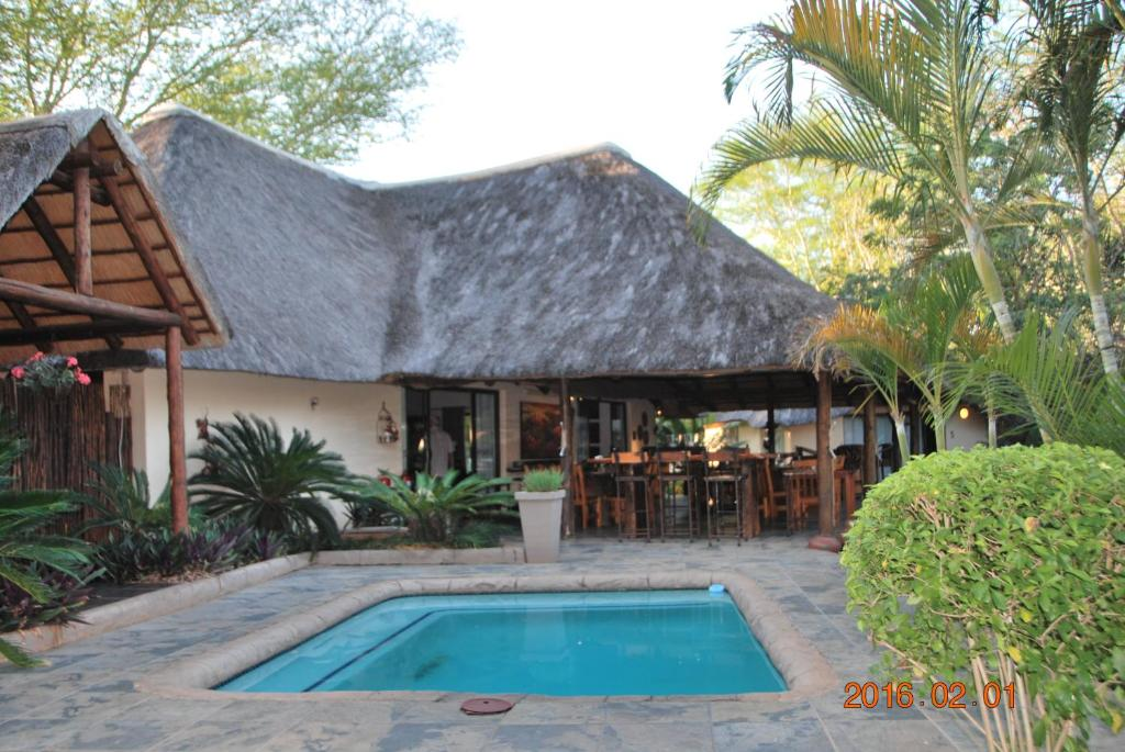 The swimming pool at or near Acasia Guest Lodge