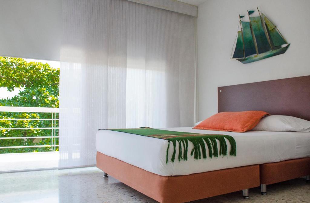 Cama o camas de una habitación en Santa Monica Alta Apartahotel