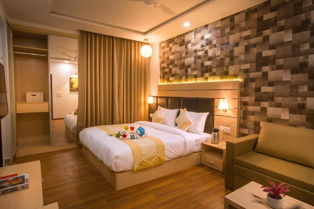 A bed or beds in a room at Kadamb Spritual stay