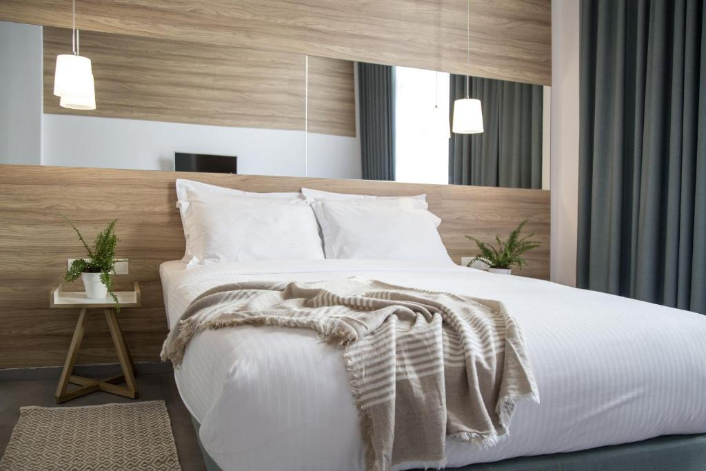 A bed or beds in a room at Monogram