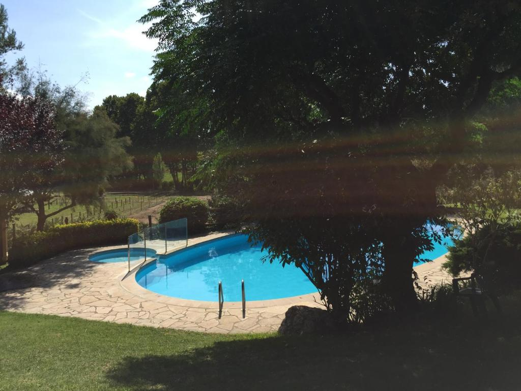 The swimming pool at or near Hotel Can Ribalta