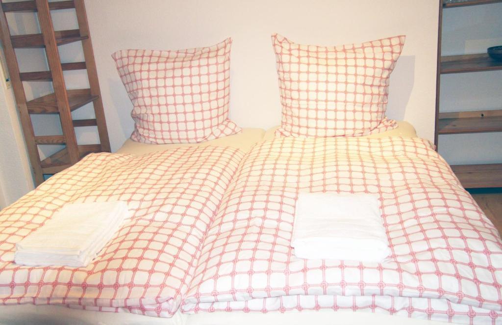 Ein Bett oder Betten in einem Zimmer der Unterkunft Holiday Apartment Zwinger