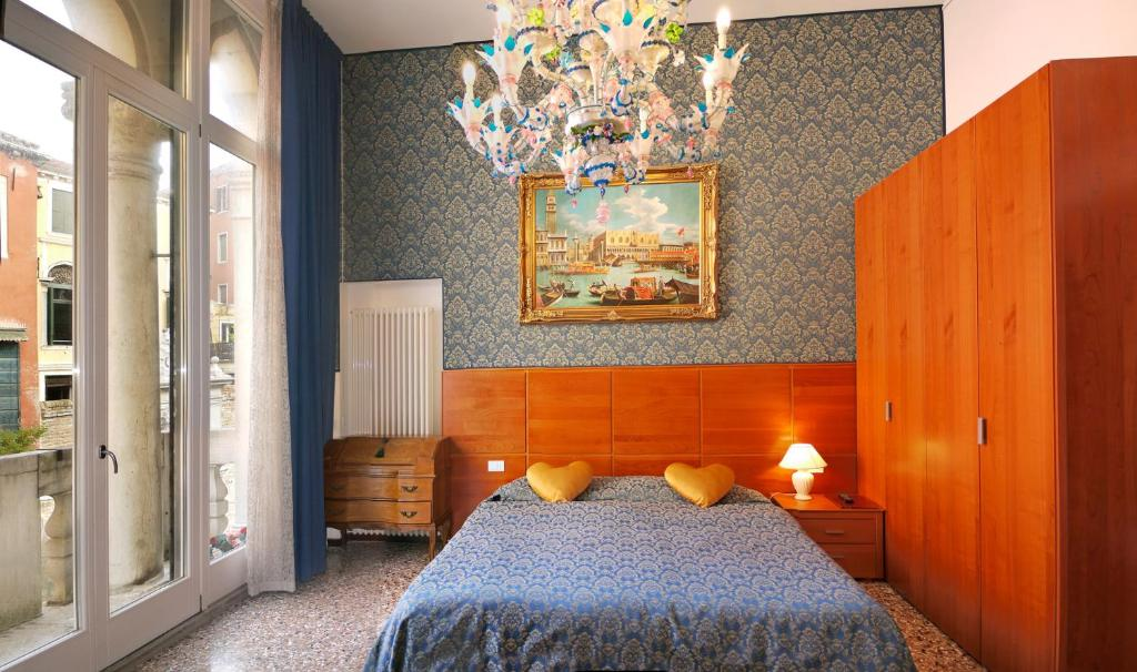A bed or beds in a room at Casa Dolce Venezia