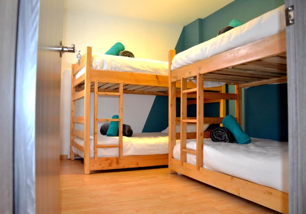 A bunk bed or bunk beds in a room at Rua Hostels Usaquén - Bogotá