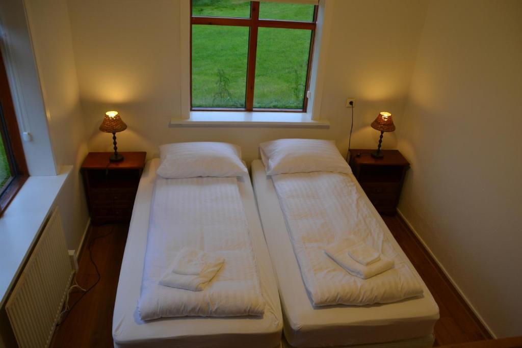 A bed or beds in a room at Lækjarhus Farm Holidays
