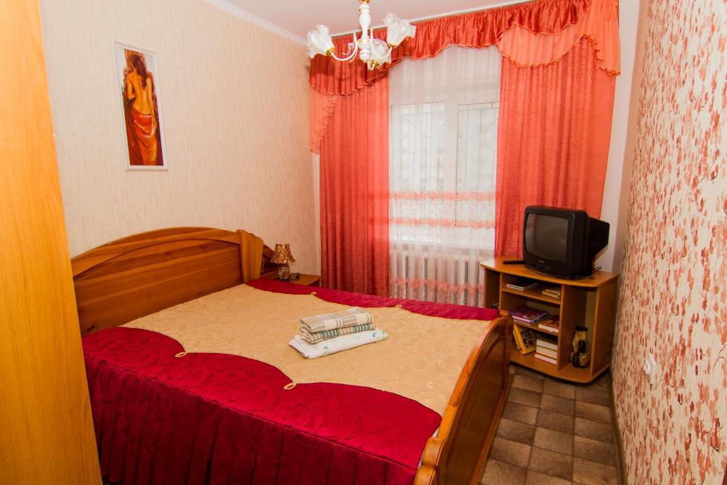 Кровать или кровати в номере Baikalskaya Zhemchuzhinka Leningradskiy Prospekt 4