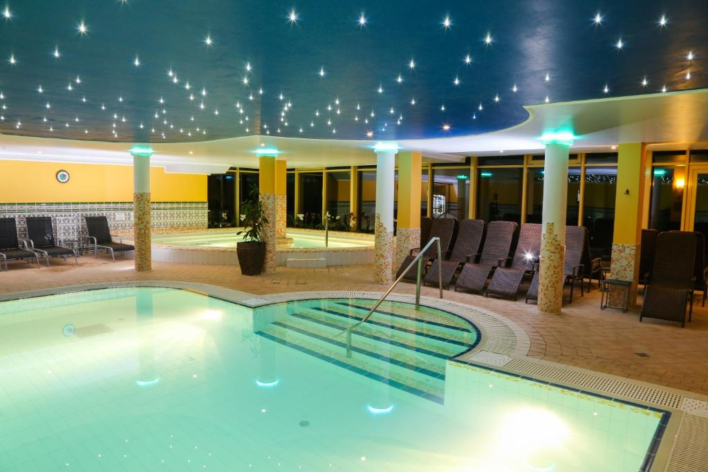 The swimming pool at or near Calimbra Wellness Hotel Superior