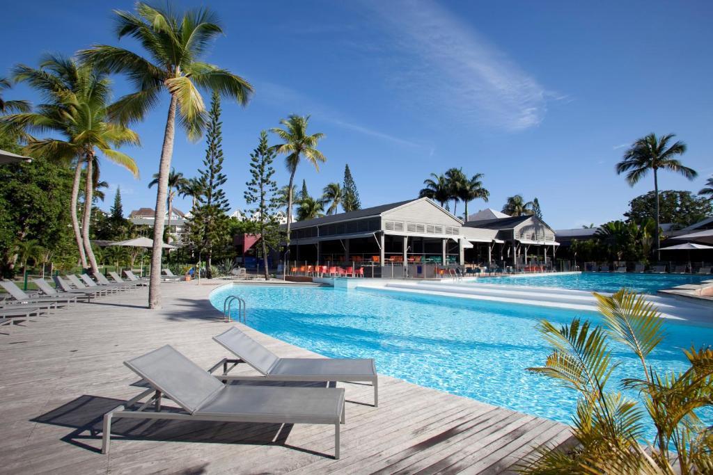 Piscine de l'établissement La Creole Beach Hotel & Spa ou située à proximité