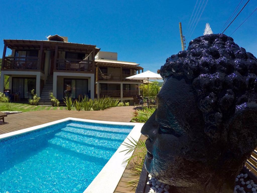 A piscina localizada em Pousada Vivenda do Rosa ou nos arredores