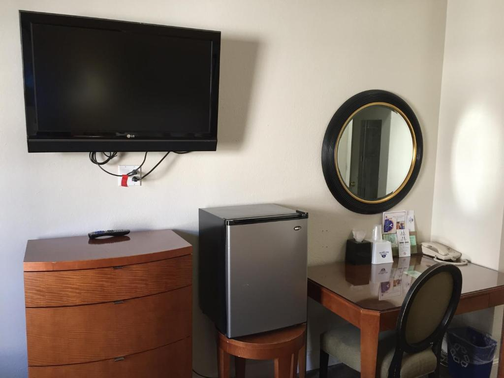 A television and/or entertainment center at Americas Best Value Inn & Suites - SoMa