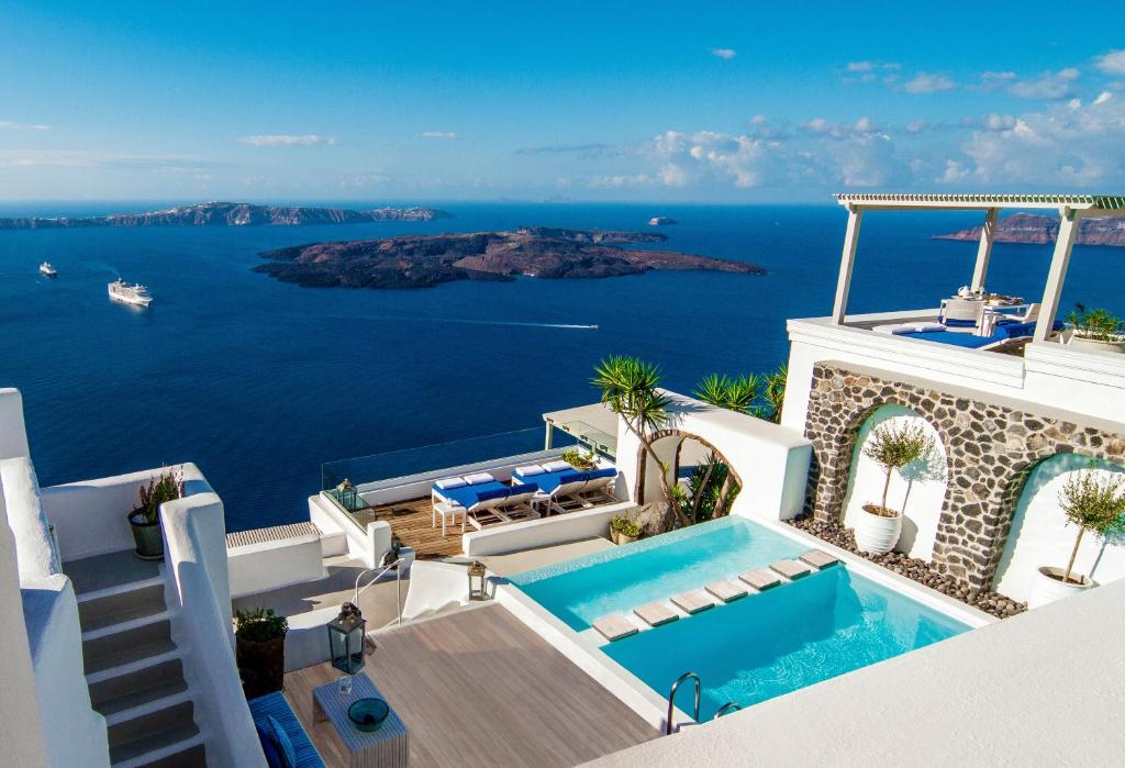 A view of the pool at Iconic Santorini, a Boutique Cave Hotel or nearby