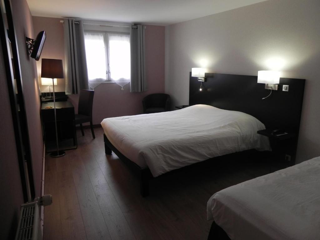 Un ou plusieurs lits dans un hébergement de l'établissement Hotel du Saumon