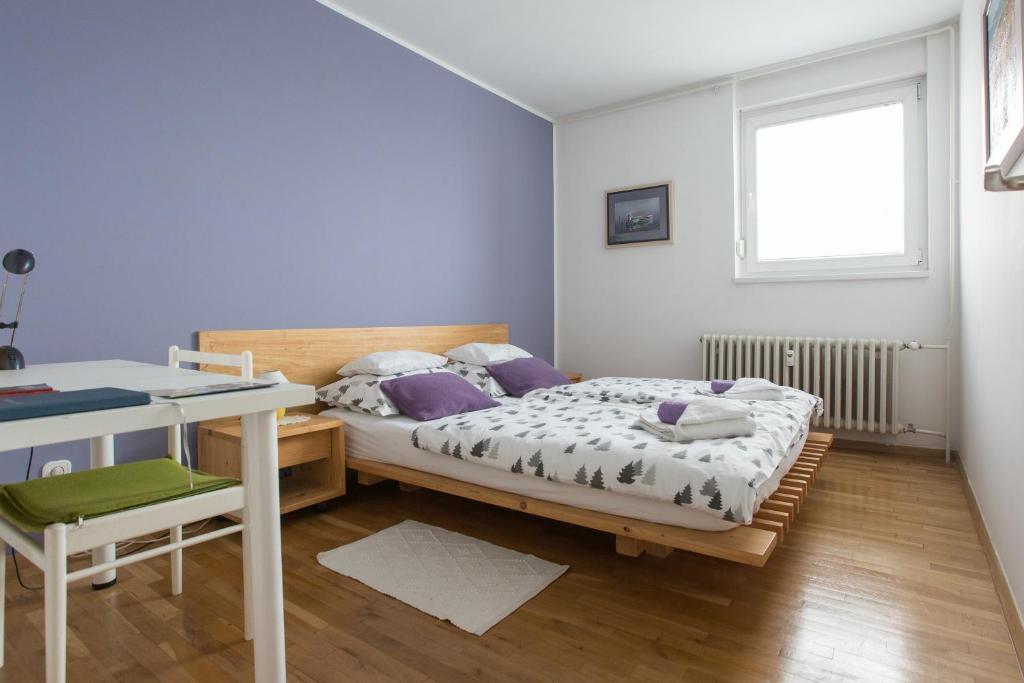 A bed or beds in a room at Apartments Zagreb Point