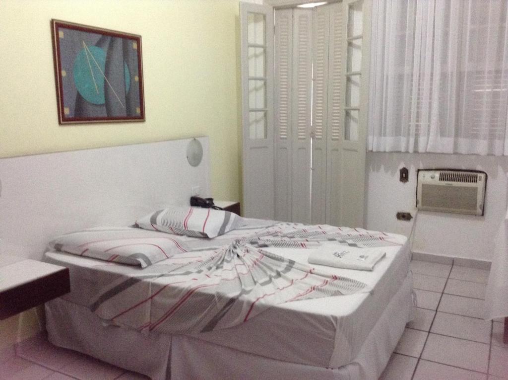 Posteľ alebo postele v izbe v ubytovaní Ritz Hotel