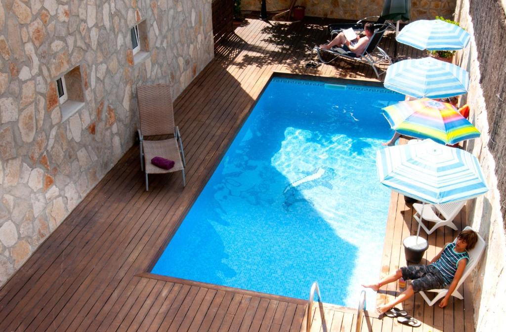 Uitzicht op het zwembad bij Hotel Marbel of in de buurt