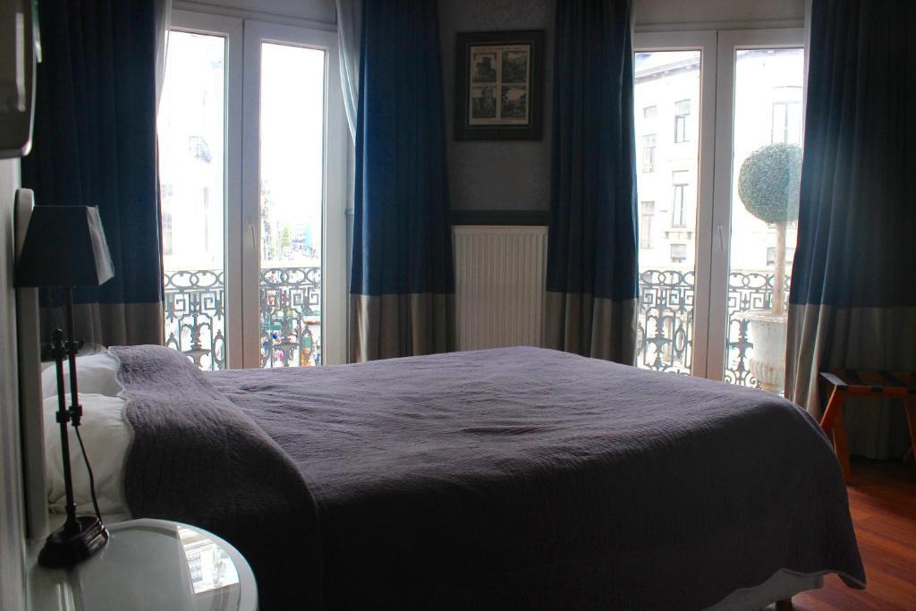 Een bed of bedden in een kamer bij Hotel Orts
