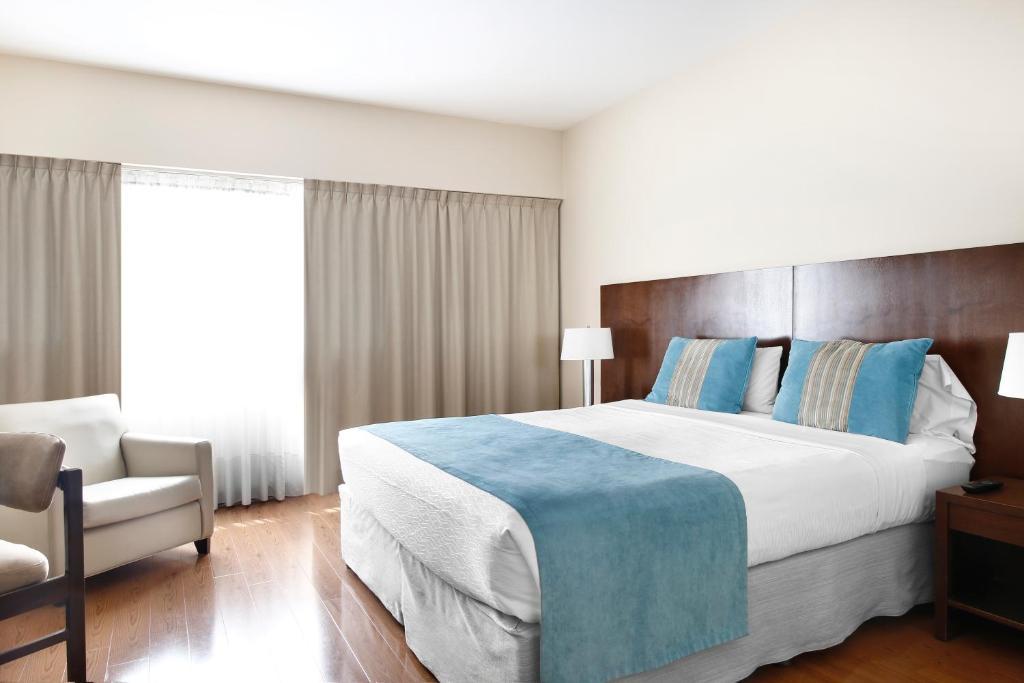 A bed or beds in a room at Cyan Hotel de Las Americas