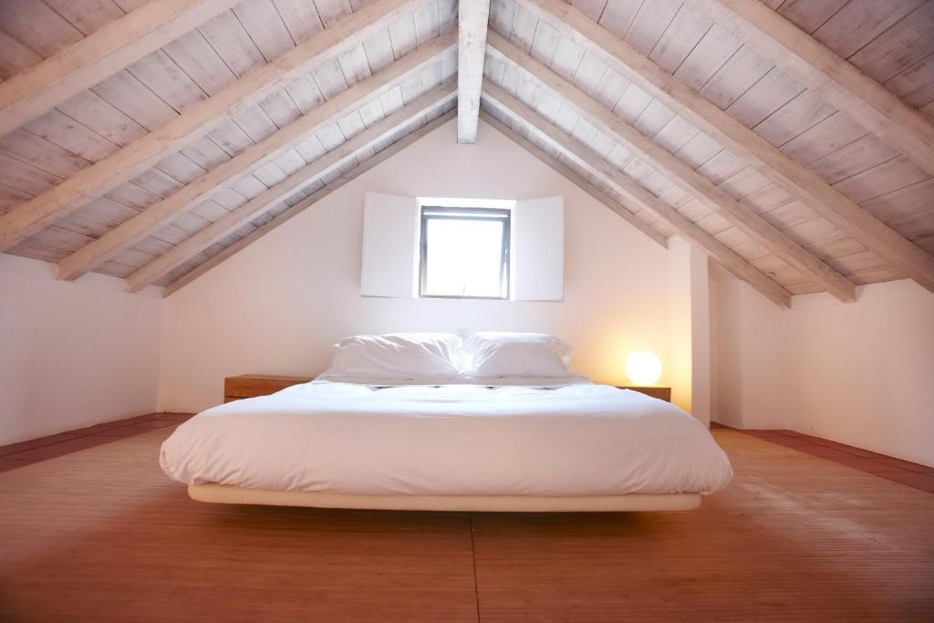A bed or beds in a room at Quinta Do Miguel