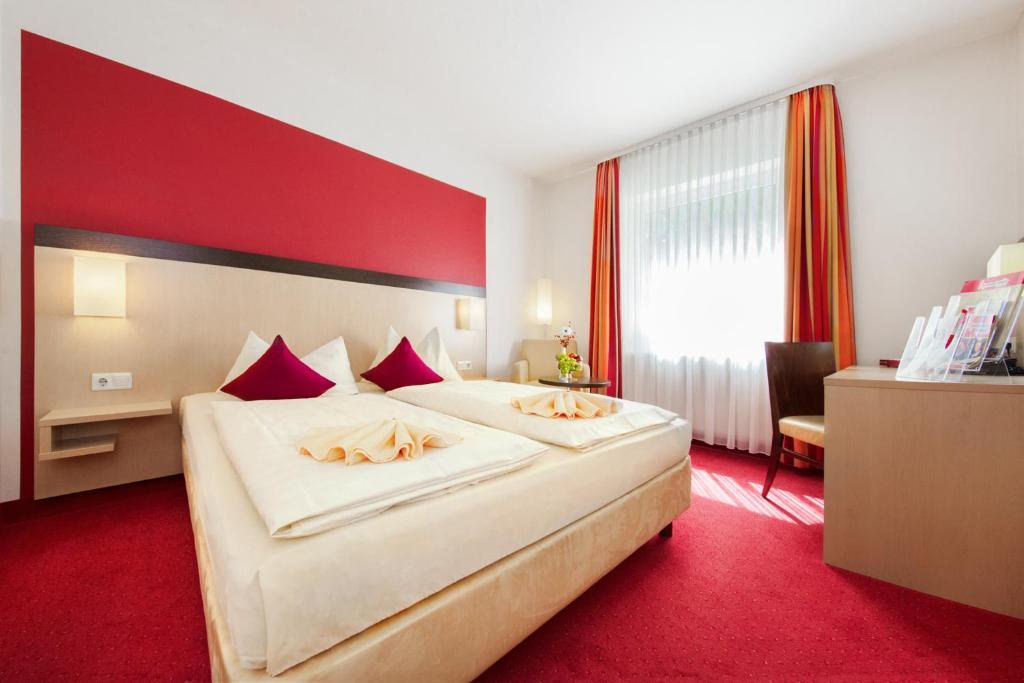 Кровать или кровати в номере Hotel Montana